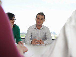Man in meeting.