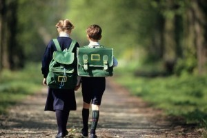 Two children walking to school.