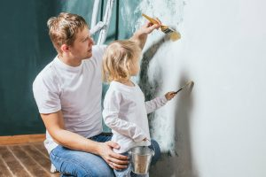 Father painting with daughter