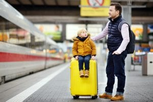 father and child with suitcase
